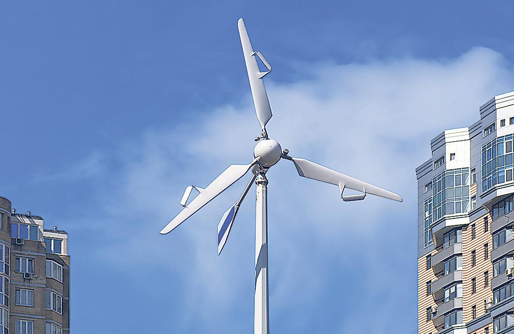 Eine Windkraftanlage vor blauem Himmel. Erneuerbare Energien brauchen Smart Grids