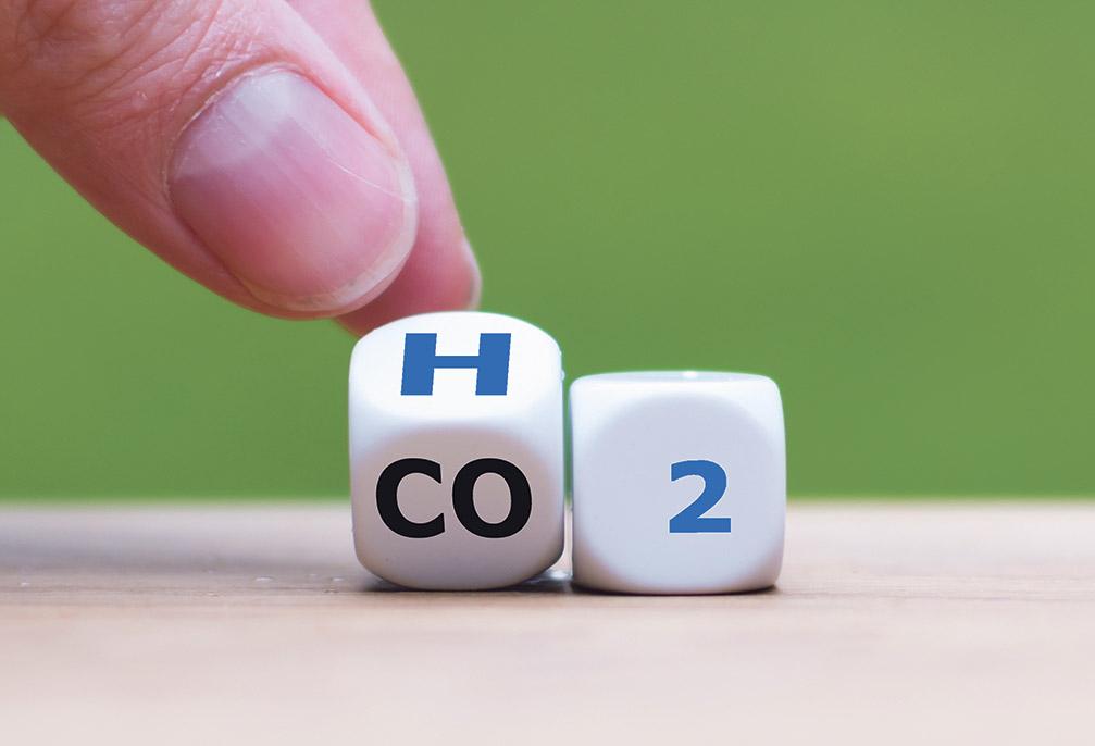 Würfel, auf denen CO2 steht, werden so gedreht, dass H2 entsteht